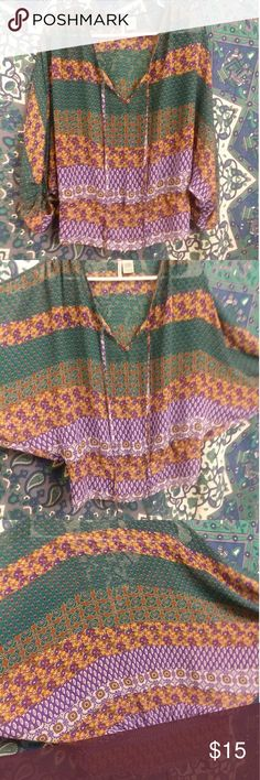 Sheer tribal print bohemian blouse This blouse has 3 quarter length sleeves The bottom has an elastic band for flattering fit Bohemian/tribal colorful print  Size: large  Tags: tribal bohemian blouse peasant top purple green brown pretty sheer flowy hippy urban outfitters uo forever 21 f21 free people thrifted iso poshmark #poshmark #poshmarkfamous Lilly Lou Tops Blouses