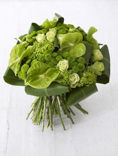 6 shamrock chrysanthemums 15 single roses 7 green santini 5 green anthurium 8 green tie leaves