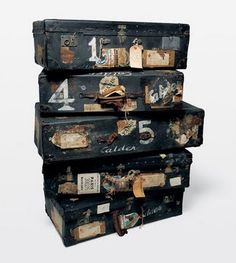 black and weathered stacked suitcase