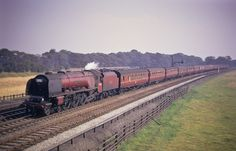 """46228 """"Duchess of Rutland"""": Coronation Class 4-6-2 heads a Down Express at Winwick. The image is testament to the quality of Kodachrome II film as well as the photographer. Photo by T. Baxendale."""
