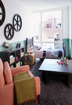boy's bedroom with wagon wheels, toys, wooden side table, and modern quilt // children's rooms