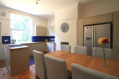 Extended wooden table for communal meals. 9 Buckingham Mount 6 Bedroom Leeds Student House Dining Room.