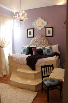 This dream bedroom was created through The StarLight Project. The young lady loves purple, white and black. The steps lift up for storage. So calming and clean looking. www.thestarlightproject.com