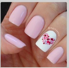 Pink nail polish with a heart