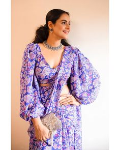 In a blue color floral saree and puff full sleeve blouse design Full Sleeves Blouse Designs, Saree Jacket Designs, Fancy Blouse Designs, Dress Designs, Trendy Sarees, Stylish Sarees, Indian Fashion Dresses, Indian Designer Outfits, Indian Outfits