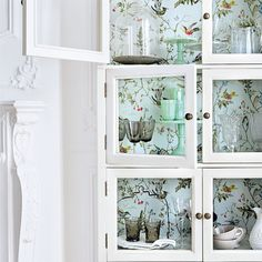 Love the wallpaper applied to the back of the cabinet, it adds sweet interest, for my cottage in the country!