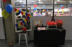 """Guests walked in to this sight. A board with all of the pictures from the photoshoot, a bucket of clown noses, and a scrapbook page to sign for the birthday boy. They also could grab their favors on the way out. The favors were little made up bags of animal crackers with a ticket tied to it that was handwritten saying, """"Thanks for Coming!"""""""