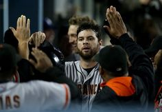 LOS ANGELES, CA - SEPTEMBER 22: Brandon Belt #9 of the San Francisco Giants celebrates in the dugout after scoring the go ahead run against the Los Angeles Dodgers at Dodger Stadium on September 22, 2014 in Los Angeles, California. The Giants won 5-2 in 13 innings. (Photo by Stephen Dunn/Getty Images)
