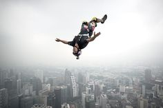 Base jumper Vincent Philippe Benjamin Reffet from France leaps from the 300-metres Open Deck of the Malaysia's landmark Kuala Lumpur Tower