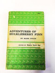 Adventures of Huckleberry Finn by Mark Twain. Paperback book. Classic literature fiction. Great American Novel. Huck Finn Tom Sawyer.