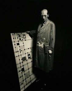 """Piet Mondrian with his last finished painting """"Broadway Boogie Woogie"""", 1943. Photo by Fritz Glarner"""
