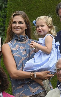 Princess Madeleine looked casual yet stylish in a bird print teal blouse while holding her daughter, the adorable Princess Leonore.