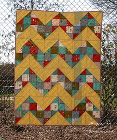pretty use of scraps - use charm pack, make 4-patch and then make into half square triangles.