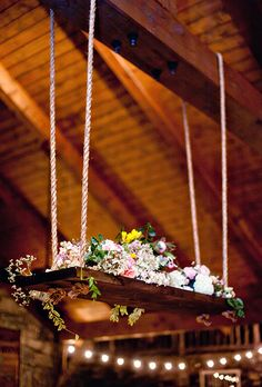 Amy Osaba created this romantic floral chandelier inspired by a swing to decorate the high ceilings in this reception space. Hanging Centerpiece, Floral Centerpieces, Wedding Centerpieces, Flower Arrangements, Wedding Decorations, Chandelier Wedding Decor, Flower Chandelier, Whimsical Wedding, Floral Wedding