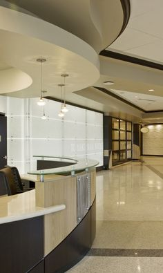 Designers will avoid changing costly items, such as the casework at the Loma Linda University. Modern Reception Desk, Reception Desk Design, Reception Table, Clinic Design, Healthcare Design, Waiting Room Design, Optometry Office, Office Ceiling, Dental Office Design