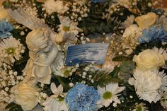 CLOSE UP BOY WREATH Funeral Flowers, Floral Design, Angel, Wreaths, Table Decorations, Home Decor, Decoration Home, Door Wreaths, Room Decor