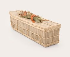 Our Cocostick coffins are made from the stems of the coconut palm leaf, which are fast growing by-products of the coconut tree.  The coconut palm leaves are dried out and the stems are removed, leaving tiny sticks.  These sticks are then strung together to create the Cocostick's desirable colour combination.  Our Cocostick coffins are available in the Traditional shape (square ends) and each comes fitted with a cotton lining. Green Funeral, Earthship, Fast Growing, Going Vegan, Decorative Boxes, Service Ideas, Traditional, Stems, Palm