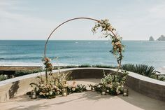 White & Blush wedding bouquet | Los Cabos Destination Wedding | Blogger's Wedding | Amy Abbott Events | Ana&Jerome Photography | Pina Cate Flower Design | Destination Wedding Tablescape | Destination Wedding Table Decor | White & Blush Table Decor with golden accents | Round Wedding Arch | Beach Wedding in Mexico | Beach Wedding Ceremony Setup