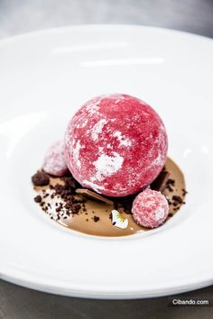Frozen pomegranate sphere on top of a tea cream with crystalized raspberries, created by Heinz Beck - la Pergola