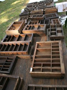 Antique Printer Trays. My daughter has one that once stored her miniature kitty collection. It was perfect!