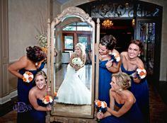 Bridesmaides and bride in mirror