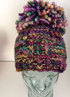This was so fun to make and it is fast!!! In just a couple of hours you have a hat! The huge pompom makes the hat -- although it is cute even without it.