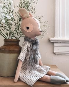 A peachy lady with a knitted scarf and a long sleeved dress because it's getting cold out there and who knows where her new home will be. She'll be in tomorrow's shop update.