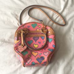 Dooney & Bourke hearts purse Beautiful purse! Not too small and not too big :) It is in excellent condition; the only sign of wear is a minor stain pictured above. Dooney & Bourke Bags