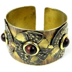 Roulette Red Tiger Eye Brass Cuff Handmade  Fair Trade Handcrafted by South African artisans. Features three discs with red tigers eye center pieces. Product Features :Gemstone colors: Deep red Colors: Brass Stone type: Tiger eye Stone high Metal: Brass Style: Cuff Finish: Polished Clasp: Simple beautiful design | brass bracelet mixed metals style jewellery accessories | unique awesome hand stamped arm candies ideas | boho chic jewelry | brass bracelet copper jewelry shape | colour bangle…