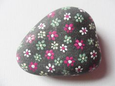 Tiny dotty flowers - medium hand painted English beach pebble paperweight by ShePaintsSeaglass on Etsy