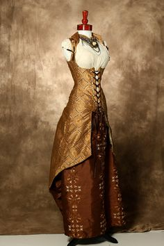 Gold Circled Tailed Vixen Peacock Coat with Brown Embroidered Line Full Length Bustle Skirt by Damsel in this Dress