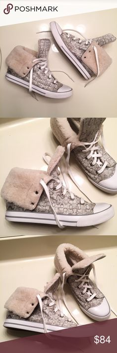 Rare Coach hightop fashion sneakers size 8 Rare faux fur hightop shiny silver fashion sneakers by Coach. Worn once but in excellent condition. Women's size 8 Coach Shoes Sneakers