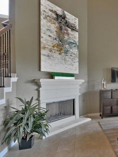 A statement-making piece of art accents this fireplace from @lennarsa