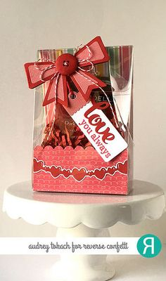 Valentine's package by Audrey Tokach. Reverse Confetti stamp set: Lovey Word Coordinates. Confetti Cuts: In the Bag, Layered Bows, Fancy Words and Double Heart Garland. Valentine's Day gift.