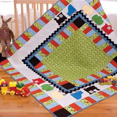 With its bold, adorable design with fun choo-choo train, the GO! On Track Quilt is an instant kid favorite. This cute quilt has an inside and outside border of rectangles cut in just minutes with your AccuQuilt GO! Fabric Cutter, this charmer of a quilt is quick and easy.GO! Dies Used to create this pattern:GO!