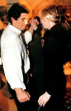 John F. Kennedy, Jr. and Carolyn Bessette Kennedy shake their tail feathers- this is love