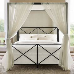 Features:  -Accommodates one standard queen-size mattress (sold separately).  -Add curtains for a serene look.  -Four-poster canopied bed.  -Requires a box spring (sold separately).  -Sleek and modern