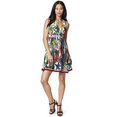 Tommy Hilfiger women's dress. Next stop, island time. Our sleeveless dress lends a decidedly tropical note to your summer wardrobe in a vibrant print, accented by knit trim along the skirt. Spun from soft, silky fabric that drapes the curves just so.<br>• Classic fit, approximately 38'' from shoulder to hem.<br>• 100% synthetic.<br>• Sleeveless, elastic waist, lined.<br>• Machine washable.<br>• Imported.<br>
