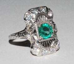 vintage emerald & diamond. Emerald is my birthstone and I dont usually wear but this I would!