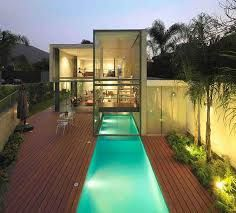 Contemporary House with Indoor Outdoor Pool Design Ideas. This simple house built on the land area of square meters in Lima, Peru. This modern-style hou Houses Architecture, Architecture Design, Outdoor Pool, Indoor Outdoor, Indoor Pond, Moderne Pools, Indoor Swimming Pools, Lap Pools, Design Moderne
