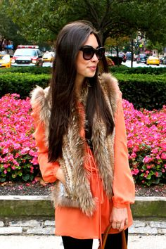 Love the bright blouse with the faux fur vest!!!