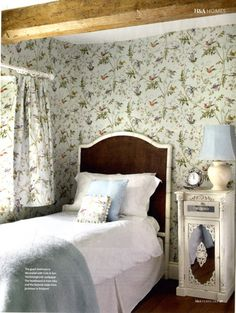 Cole & Son Hummingbird wallpaper in a bedroom.