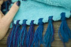 How To: Make a No Sew Blanket with Yarn Fringe - #DisneySide @ Home Celebration Princess Party Ideas