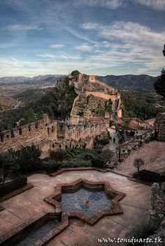 Castle of Xàtiva, Valencia - Spain - on the ancient roadway Via Augusta leading from Rome across the Pyrenees and down the Mediterranean coast to Cartagena and Cádiz. Places Around The World, The Places Youll Go, Places To See, Photo Chateau, Valence, Spain And Portugal, Spain Travel, Adventure Is Out There, Wonders Of The World