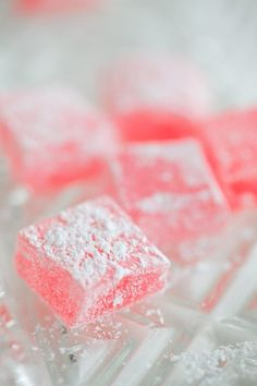 Turkish delights:  ingredients  8 oz. water  1 oz. gelatine  14 oz. sugar  ¼ tsp. citric acid  ½ tsp. vanilla essence  2 tsp. triple-strength rose water  pink food colouring - optional  2oz. powdered sugar  1 oz. cornflour