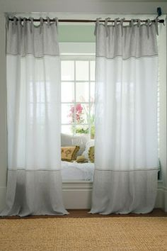 I like the curtains on the outside of the window seat. I want to do this in our living room.
