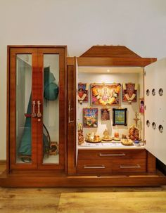 Discover some small pooja cabinet designs; you can place them anywhere in the house. Go for a standalone or a custom built-in pooja cabinet. Pooja Room Design, Room Design, Pooja Rooms, Bedroom Cupboard Designs, Temple Design For Home, Room Door Design, Bathroom Design Small, Kitchen Door Designs, Pooja Room Door Design