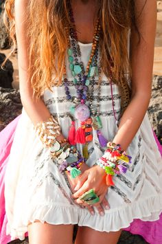 Bright colored bracelets and necklaces with a white dress. Ultimate #boho #gypsy #chic