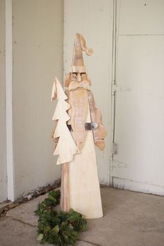 This tall and skinny Santa has a look that harkens back to the older European images of jolly old St. Nick. The slightly whitewashed natural wood is a refreshing twist on the traditional red or green.