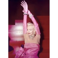 """Though red lips had already been worn by every Hollywood actress, magazine pin-up, and school nurse by 1953, this red lipstick moment from Gentlemen Prefer Blondes is the unforgettable one for generations of makeup artists: Marilyn Monroe, singing """"Diamonds Are a Girl's Best Friend"""" in a strapless pink dress and gloves. (The scene was recreated in 1985 for Madonna's """"Material Girl."""")"""